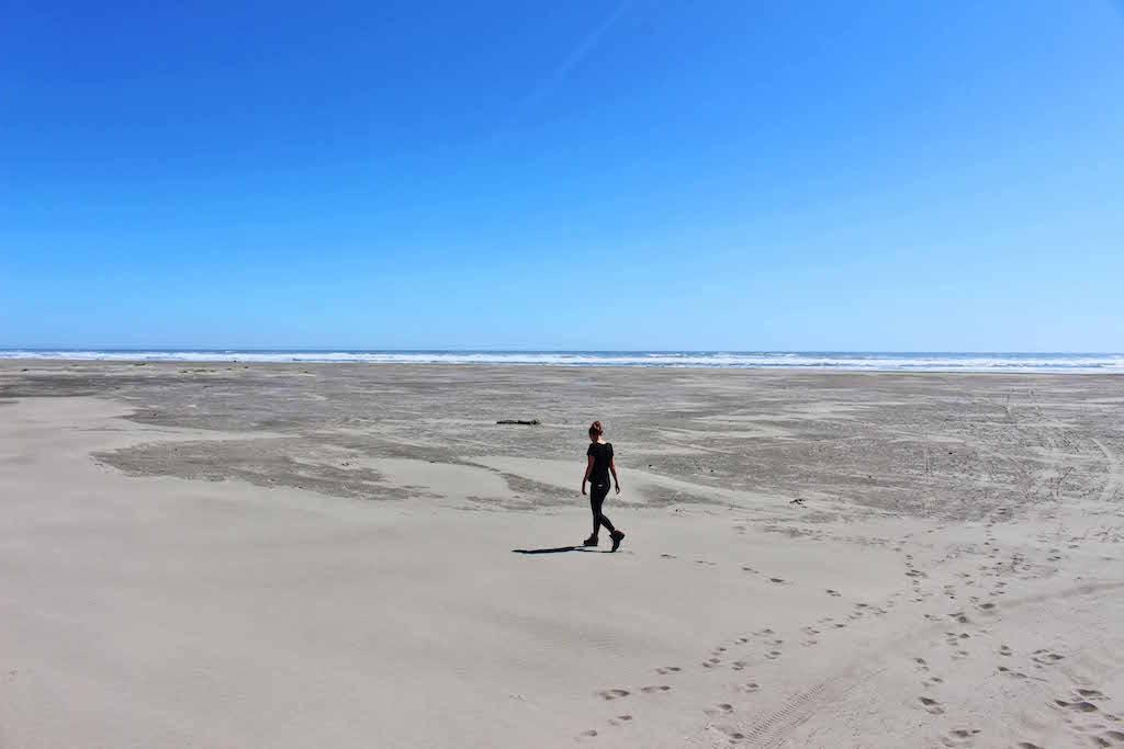 Chiloe Lyndsay walking across beach Inca to inuit