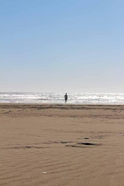 Jake on beach, Chiloe, Inca to inuit