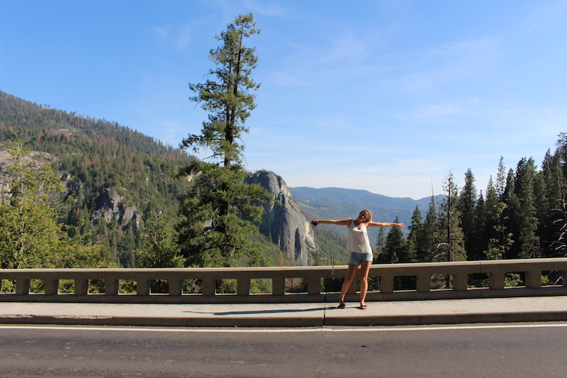 Lyndsay standing on a bridge in Yosemite